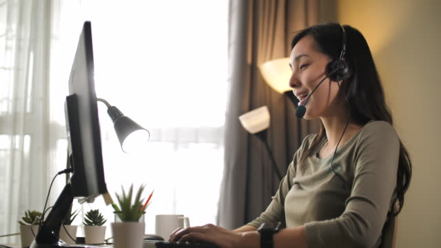 asian woman call support at home - call center stock videos & royalty-free footage