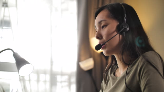 asian woman call support at home - headset stock videos & royalty-free footage
