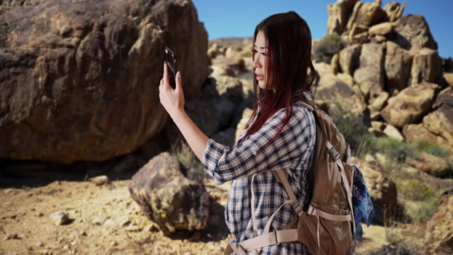 Asian woman can't get cell service in the desert