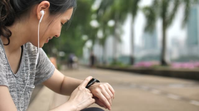 asian woman checking smart watch - smart watch stock videos & royalty-free footage