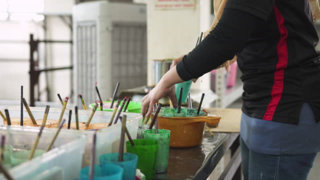 asian woman choosing the colour and brush for a batik - batik stock videos and b-roll footage