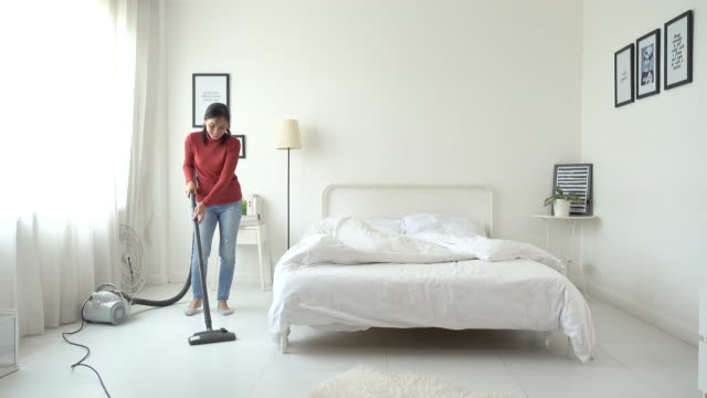 asian woman cleaning room with vacuum cleaner - domestic room stock videos & royalty-free footage