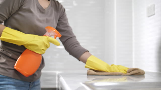 asian woman cleaning untidy kitchen - latex glove stock videos & royalty-free footage