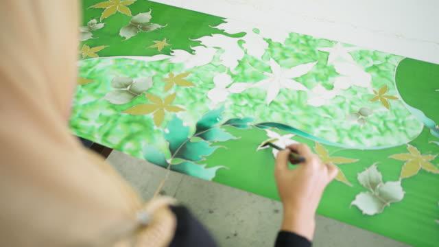 asian woman colouring her batik - batik stock videos and b-roll footage