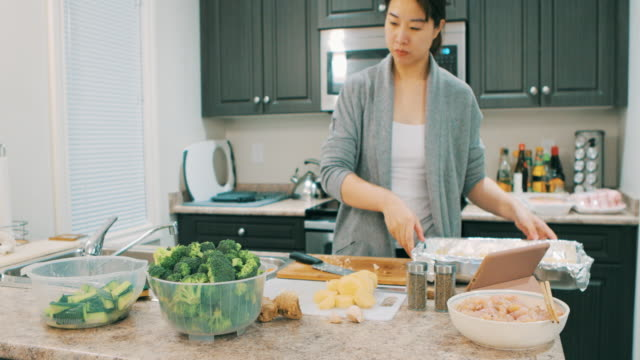 asian woman cooking health food in kitchen - cauliflower stock videos & royalty-free footage