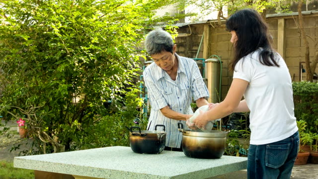 asian woman cooking in the garden - soy milk stock videos and b-roll footage