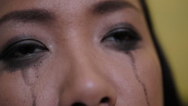 Asian woman crying close up shot