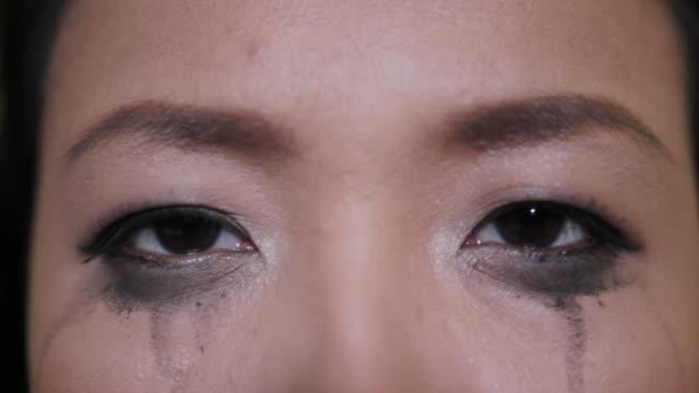 Asian woman crying mascara