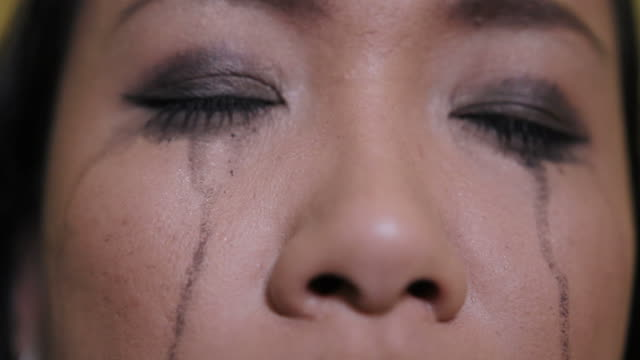 Asian woman crying