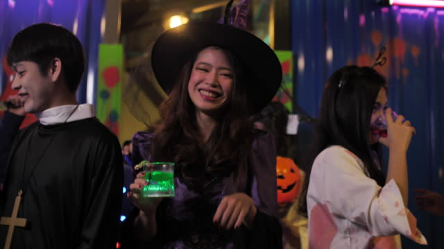 asian woman dancing at night halloween party.in halloween party - dungeon stock videos & royalty-free footage