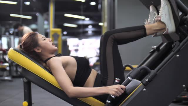 asian woman doing leg press exercise in gym - leg press stock videos & royalty-free footage