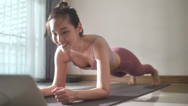 asian woman doing planking at home - plank stock videos & royalty-free footage