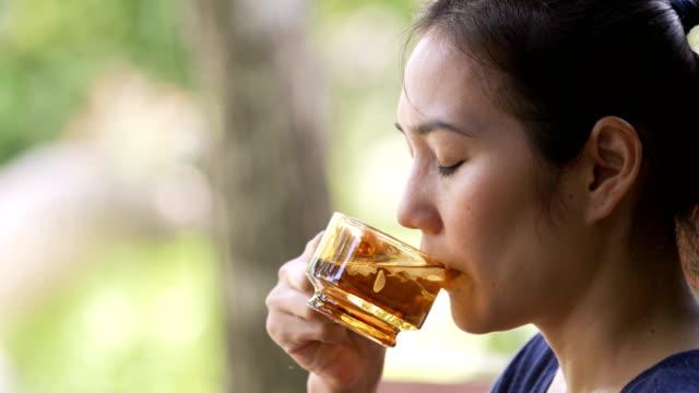cs 4k asian woman drinking hot sakura flowering tea. - tea hot drink stock videos & royalty-free footage