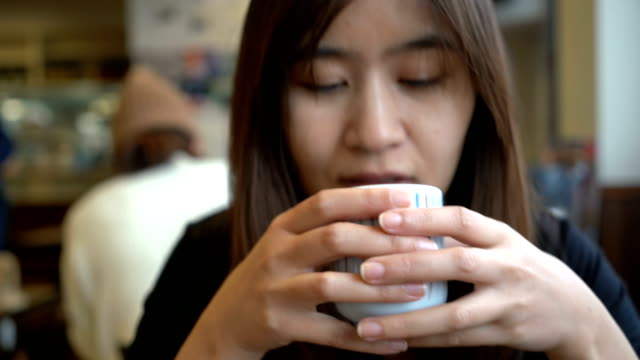 asian woman drinking japanese hot tea in restaurant - tea hot drink stock videos & royalty-free footage