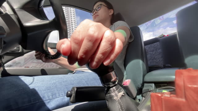 slo mo asian woman driving a manual transmission - stick plant part stock videos & royalty-free footage