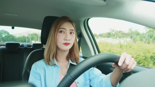 asian woman driving car - korean ethnicity stock videos & royalty-free footage