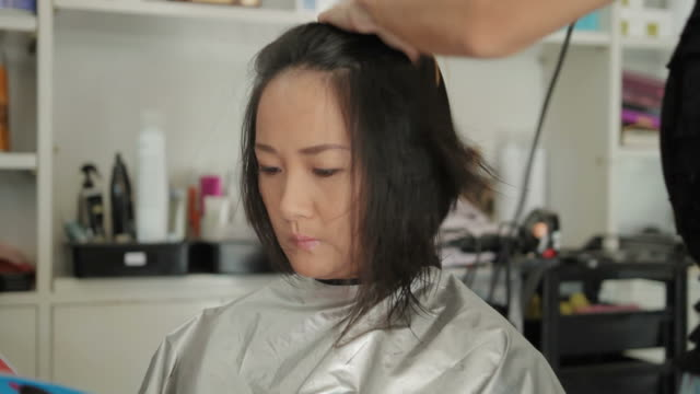 Asian Woman Drying Hair After Haircut In Beauty Salon Stock Footage