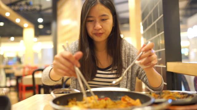 asian woman eating korean food, tteokbokki noodles soup - south korea stock videos & royalty-free footage