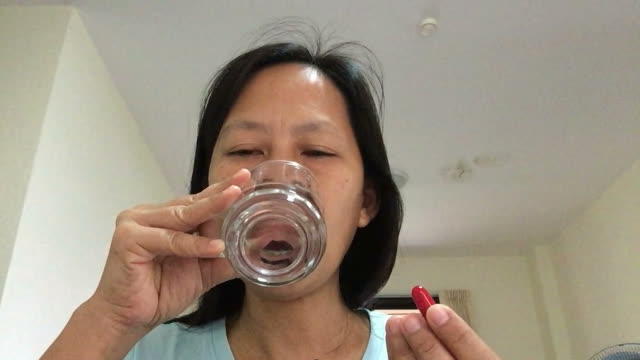 asian woman eating pill - antibiotic stock videos and b-roll footage