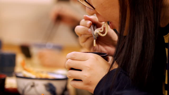 asian woman eating soba in japanese restaurant - soba stock videos & royalty-free footage