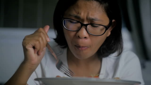 asian woman eating spicy thai green papaya salad, slow motion - spice stock videos and b-roll footage