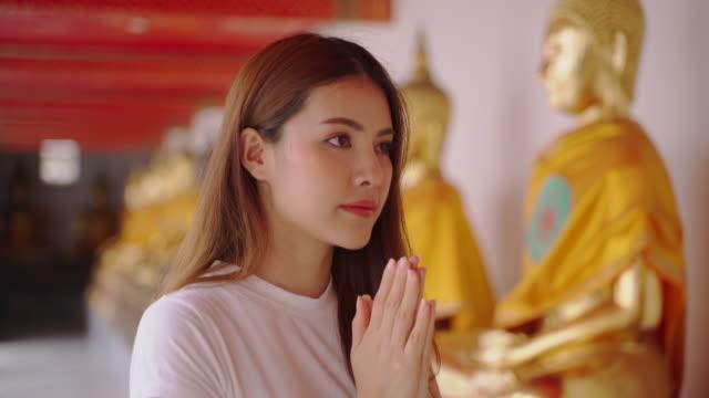 asian woman enjoying for landmark of bangkok wat pho in bangkok city - buddha stock videos & royalty-free footage