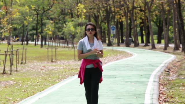Asian woman exercise in garden