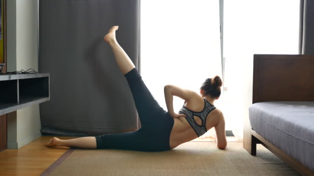 asian woman exercising at home - pilates stock videos & royalty-free footage