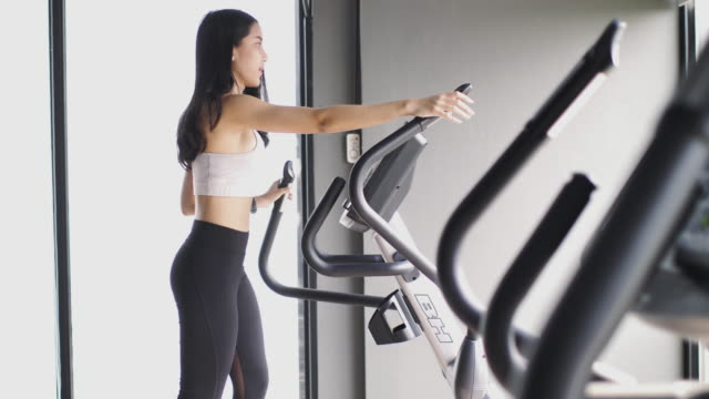 asian woman exercising in gym - rowing machine stock videos & royalty-free footage