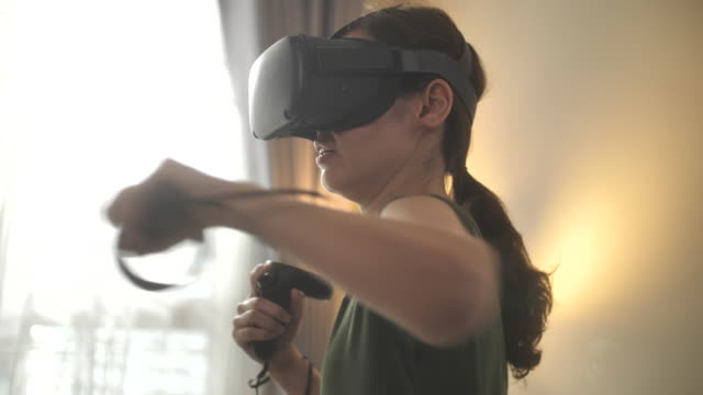 asian woman exercising using vr glasses at home - cyberspace stock videos & royalty-free footage