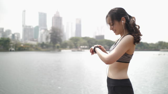 asian woman exercising with technology - interval start stock videos & royalty-free footage