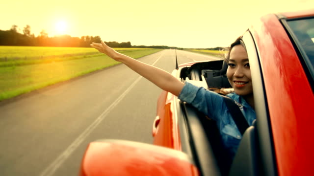 Asian woman experiences freedom on the highway