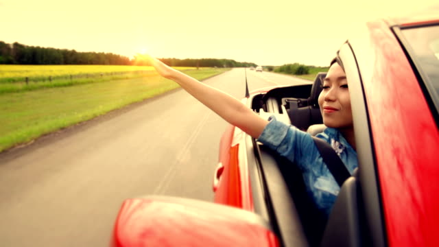 asian woman experiences freedom on the highway - daydreaming stock videos & royalty-free footage