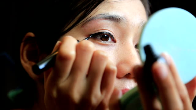 asian woman eye make up - blusher make up stock videos and b-roll footage