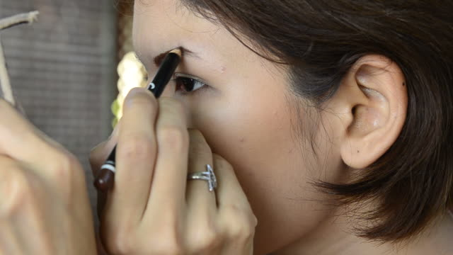 cu : asian woman eye make up - blusher make up stock videos and b-roll footage