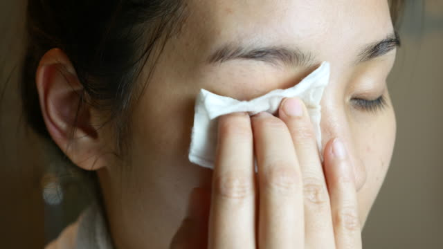 Asian Woman Face cleansing  with cotton pad