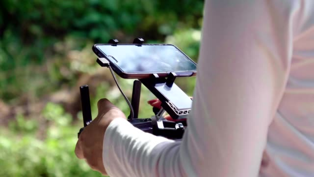 asian woman farmer pilot using drone remote controller - pilot stock videos and b-roll footage