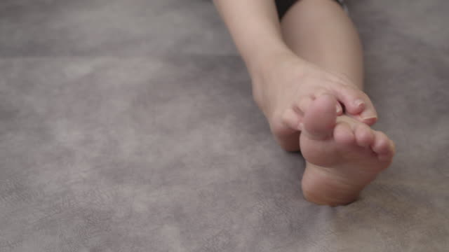 asian woman feel pain on her feet - barefoot stock videos & royalty-free footage
