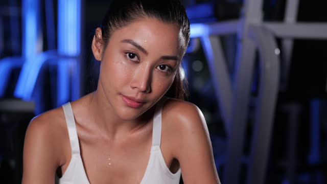 asian woman finished exercising and was drenched in sweat, she looking at the camera. - drenched stock videos & royalty-free footage