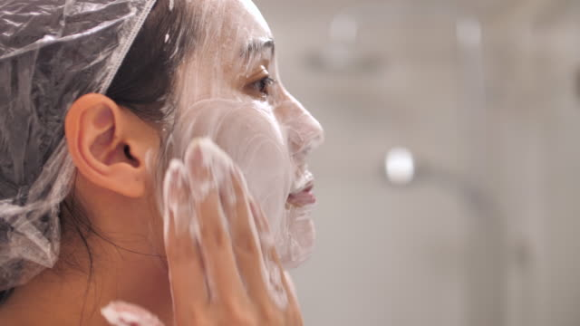 asian woman foam washing face with clean water at bathroom - caucasian appearance stock videos & royalty-free footage