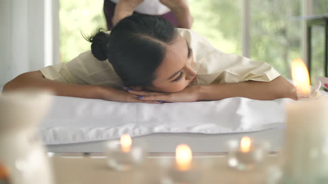 asian woman gets back massage spa by massage therapist - human back stock videos & royalty-free footage