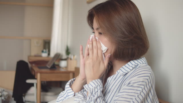 asian woman got flu sneezing in tissue sit on bed - facial tissue stock videos & royalty-free footage