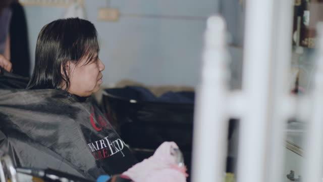 asian woman haircut in beauty salon - beauty spa stock videos & royalty-free footage