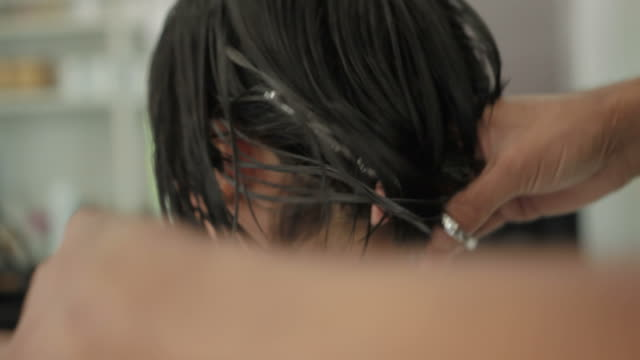 Asian woman haircut in beauty salon