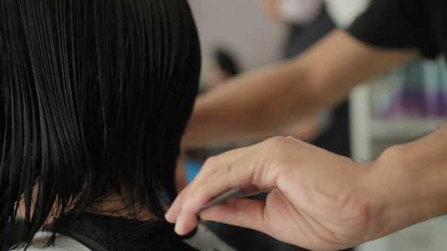 asian woman haircut in beauty salon - cutting hair stock videos and b-roll footage