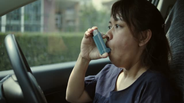 asian woman having asthma attack in the car - asthmatic stock videos and b-roll footage