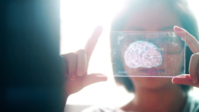 asian woman holding the technological digital holographic interface of the human brain. artificial intelligence concept. - computazione quantistica video stock e b–roll