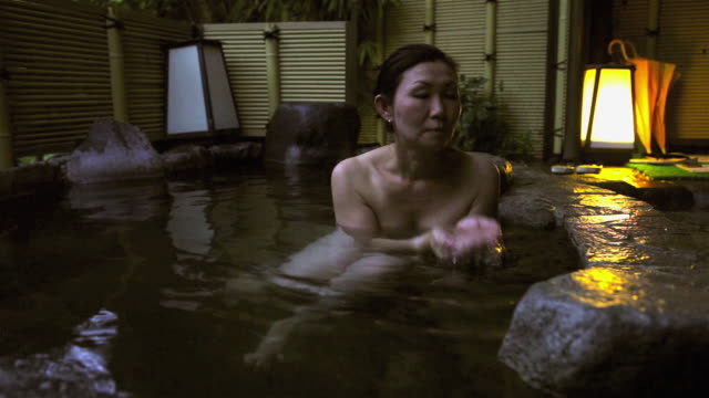 Asian Woman In Japanese Hot Tub In Hakone Japan Stock Footage Video