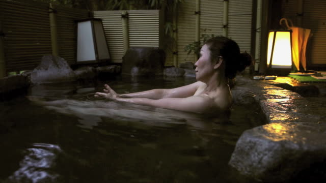 asian woman in japanese hot tub in hakone, japan - hair bun stock videos and b-roll footage