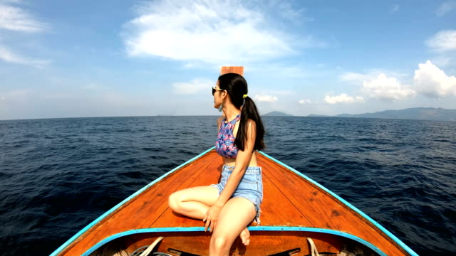 asian woman in thai taxi boat at lipe, satun, thailand - water taxi stock videos & royalty-free footage